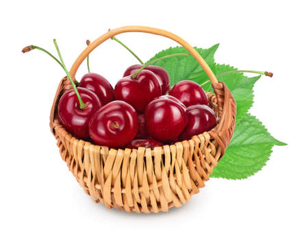 red sweet cherry in a wicker basket isolated on white background with clipping path and full depth of field