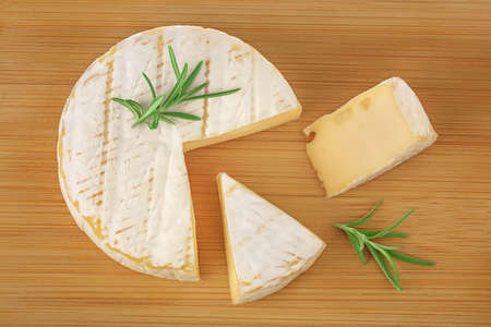 Camembert cheese on wooden background with full depth of field. Top view. Flat lay Reklamní fotografie