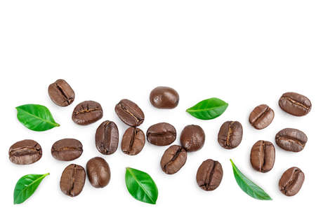 Heap of roasted coffee beans with leaves isolated on white background . Top view. Flat lay.