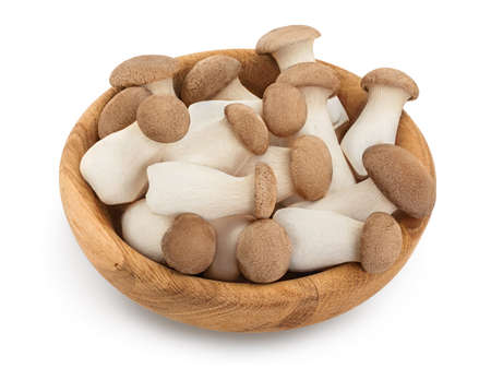 King Oyster mushroom or Eringi in wooden bowl isolated on white background with clipping path and full depth of field. Standard-Bild