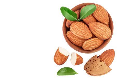 Almonds nuts in wooden bowl isolated on white background . Top view with copy space for your text. Flat lay