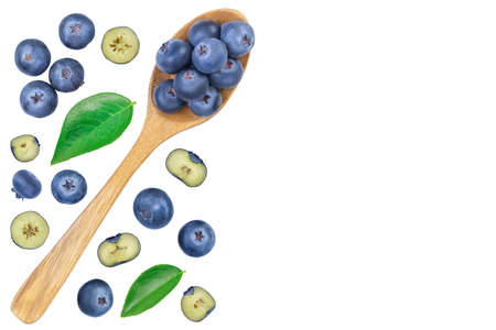 fresh ripe blueberry in wooden spoon isolated on white background. Top view with copy space for your text. Flat lay
