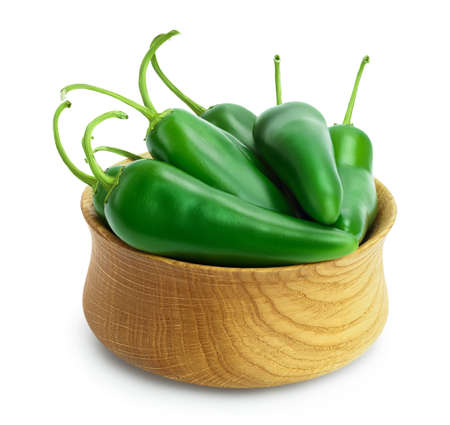 jalapeno pepper in wooden bowl isolated on white background. Green chili pepper  full depth of field.