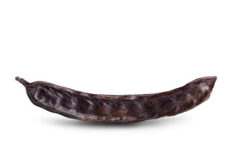 Ripe carob pods isolated on white background with clipping path and full depth of field