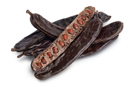 Ripe carob pods and bean isolated on white background with clipping path and full depth of field 版權商用圖片