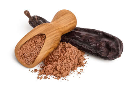 Carob pod and powder in wooden scoop isolated on white background with and full depth of field.