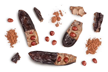 Carob pod and powder isolated on white background with clipping path and full depth of field. Top view. Flat lay 版權商用圖片