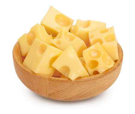 cubes of cheese in wooden bowl isolated on white background
