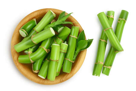 Green bamboo in wooden bowl isolated on white background with and full depth of field. Top view. Flat lay Banque d'images