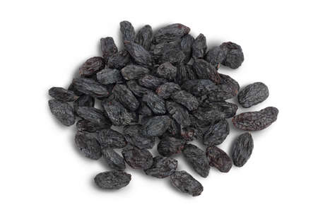 Black raisin isolated on white background with path. Top view. Flat lay