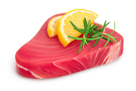 Fresh tuna fish fillet steak with rosemary and lemon isolated on white background with path and full depth of field
