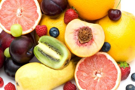 Composition of fresh fruit on a white background. photo