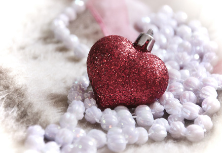 glass heart and beads, artificial love photo