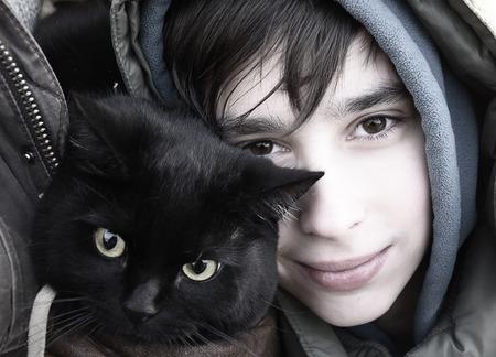 Boy with black cat, winter portrait Zdjęcie Seryjne