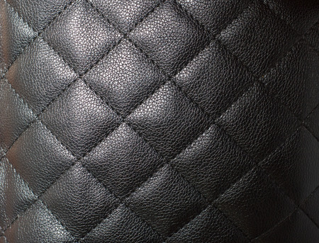 quilted: texture leather quilted, black cloth for background and texture abstract