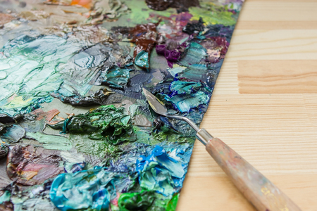 artist brushes, palette knife and palette with paints impressionist oil painting, paint