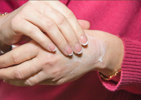 antibacterial soap: applying a cosmetic hand soap, hand wash, body care, cleanliness and hygiene
