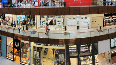 mall of the emirates: Dubai Mall, a top view of the inside, boutiques and shops, people walking and shopping, United Arab Emirates April 14, 2014, very soft focus, out of focus Editorial