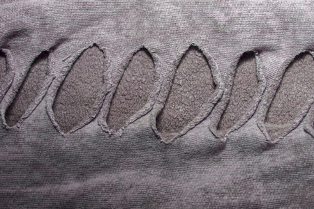 fabric textures: cotton fabric texture with slots with holes for the background and abstract textures Stock Photo