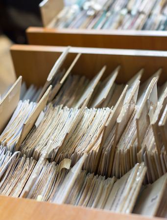 data archiving: File folders in a file cabinet, card catalog in a library, closeup