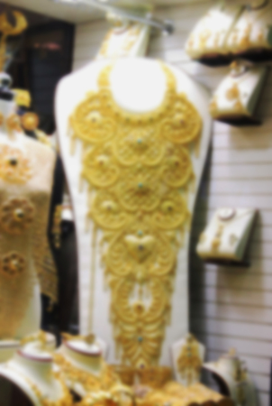 gold souk: the gold market, gold jewelry and clothing, blurred