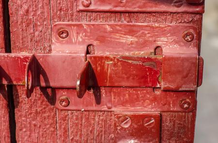 door bolt: Old wooden door with bolt, shabby door
