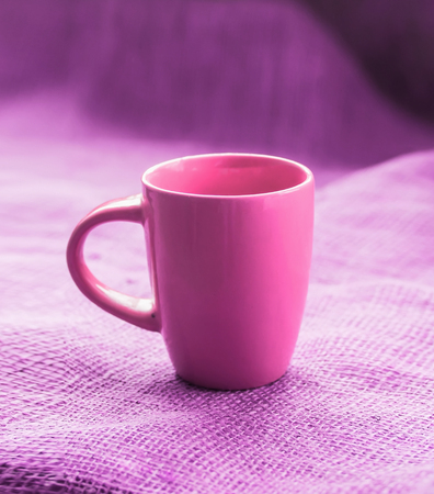 invigorating: cup on the table on the tablecloth, isolated, with a hot drink invigorating