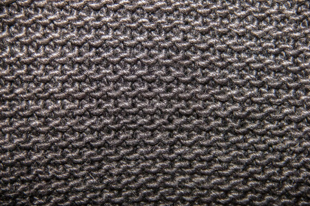 tejido de lana: knitted woolen fabric of black color, large loop, texture and background