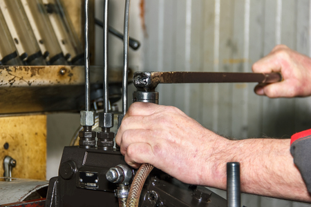 injector: Professional mechanics testing diesel injector in his workshop, repair of diesel fuel injectors, ustroustvo for the diagnosis of fuel injectors soft focus