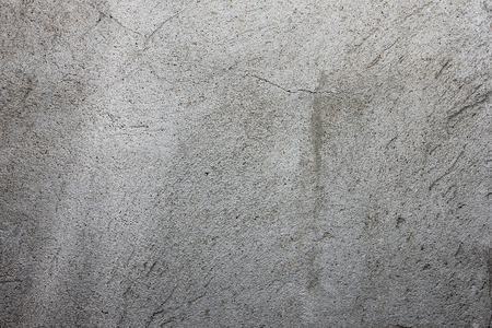 gray texture with scratched plaster on the wall, for background and designg Stock Photo