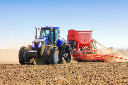 Work of a powerful tractor in field cultivation and cultivation. Agronomy, the concept of agriculture.
