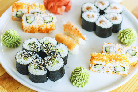 The best sushi rolls, Japanese cuisine. Different delicious kinds of sushi rolls. Cooking.