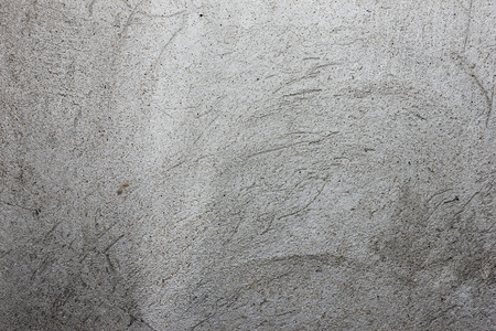 gray texture with scratched plaster on the wall, for background and design Stock Photo