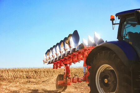 combine harvester, working on the harvest of a ripe sunflower. Agriculture. Cultivated area. The concept of agronomy, agriculture, livestock. Stock Photo