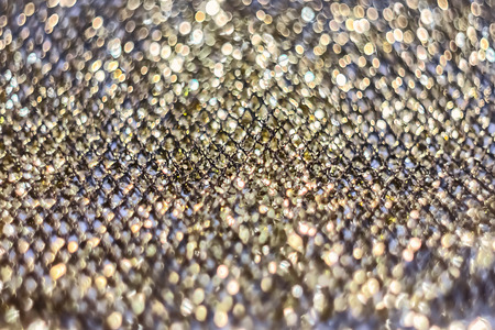 texture of golden shiny fabric mesh, for design and creativity, on a gray background