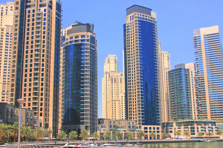 Dubai, UAE April 4, 2014. Embankment of Dubai Marina. High Commercial buildings and hotels, luxury yachts, recreation area Editorial