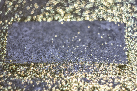 Luxury golden shine background. Golden glitter texture for a Christmas card, banner, cover and a luxury card