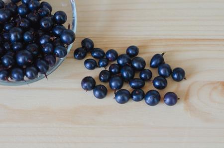 blackberry bush: black currant on yhe table Stock Photo