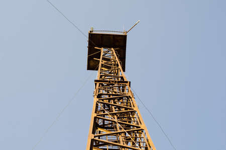 rusty old metal structure of a telecommunication tower, bottom view