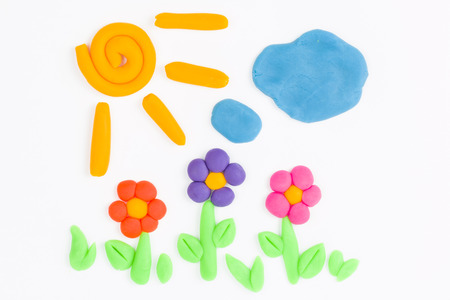 Plasticine sun, sky, cloud and flower