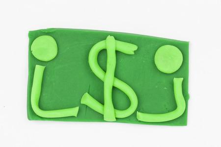 child s block: Dollar from children bright plasticine - Stock Image macro