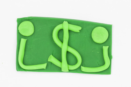 Dollar from children bright plasticine - Stock Image macro
