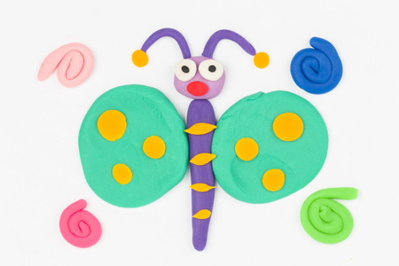 Butterfly  from children bright plasticine - Stock Image macro  Stock Photo