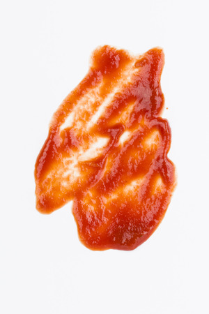 squirting ketchup: Ketchup blood stains - Stock Image
