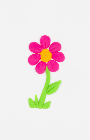 multiple image: Flower from children bright plasticine.