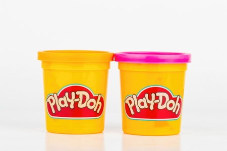 Rostov - on - Don, Russia - July 19, 2015: This is a studio shot of containers of various colored Play Doh modeling clays. Play Doh is manufactured by Hasbro.