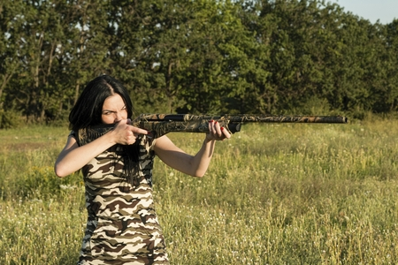 Beautiful woman hunter with Rifle. Stock Image.
