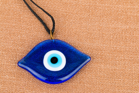 Evil eye bead - Stock image macro.