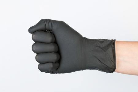 hypoallergenic: Hand in black medical glove. Stock image macro.