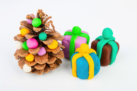 pomme de pin: Pine cone and plasticine gift. Stock image macro. Banque d'images